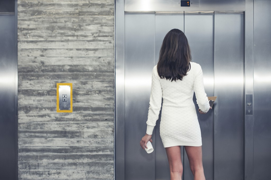 iStock_000050757486_Woman waiting for elevator