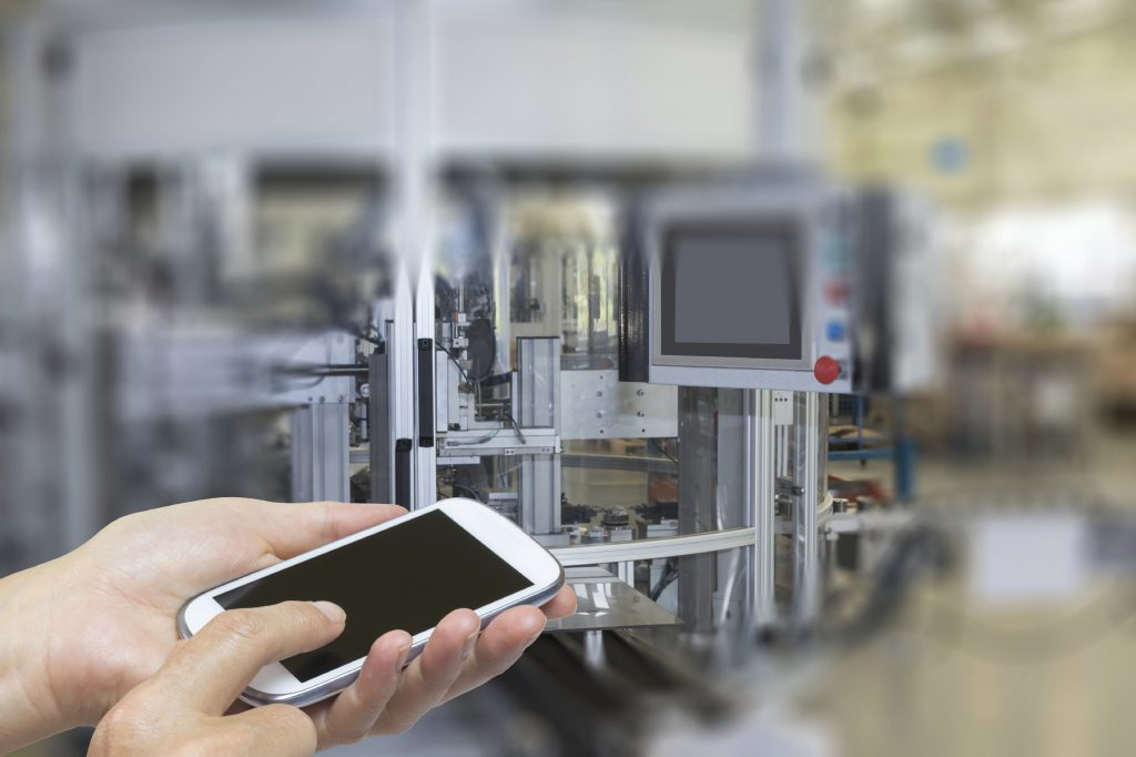 The Fourth Industrial Revolution could include the scenario of a person operating an automated industrial environment with a smartphone.